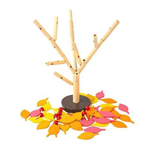 Autumn leaf pieces fallen off of wooden toy tree.