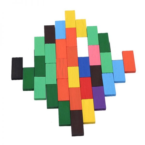 Bright colored dominos laid out as a pattern on a flat surface.