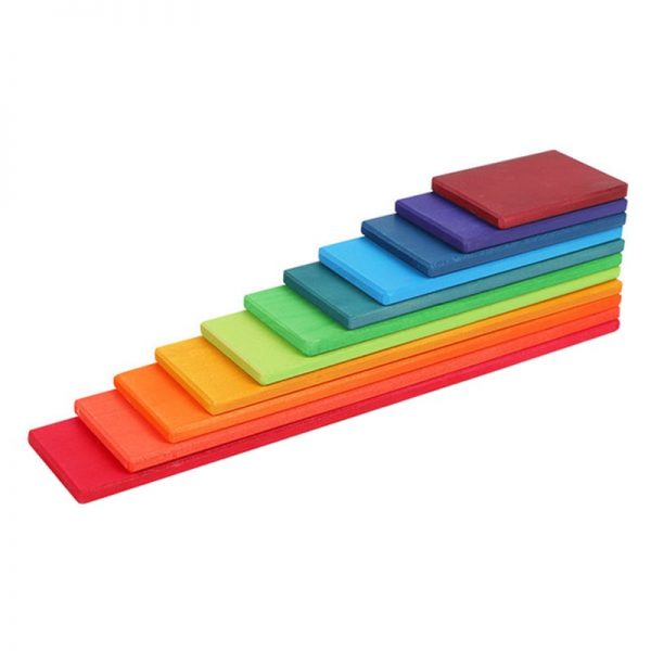 Colorful stacking boards lined up to display the pieces' various lengths.