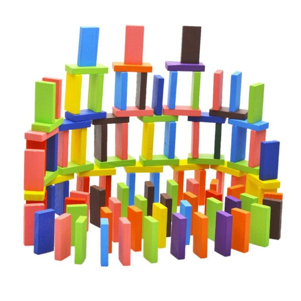 Domino pieces stacked up to create a colorful building.