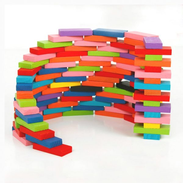 Domino set used to build a curved wooden brick wall structure.