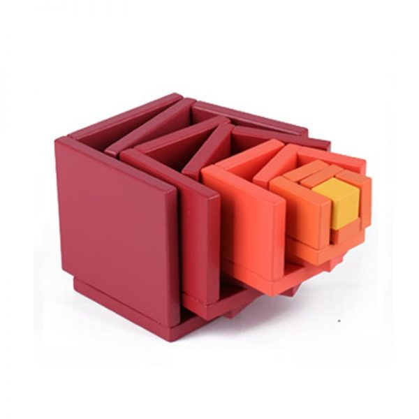 Several red matrix box pieces juxtaposed together, to demonstrate how it fits together.