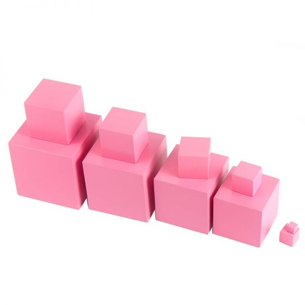 Smaller sized pink wooden boxes stacked on top of larger boxes.