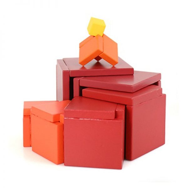 Red matrix stacking box pieces extended to display the toy's versatility.