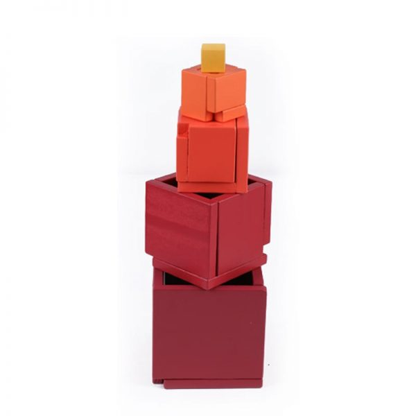 Tall standing tower made using red stacking box toy.