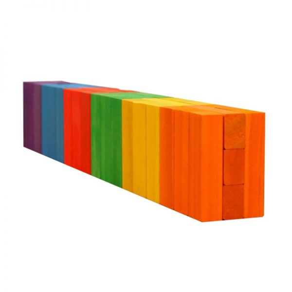 Wooden jumbling blocks on a flat surface, sorted by color.