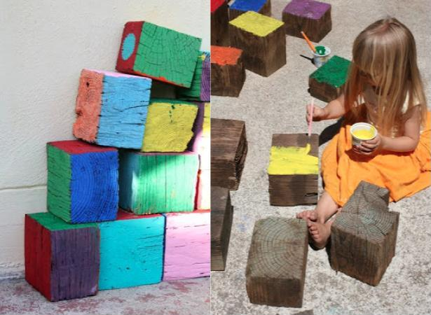girl making diy giant outdoor blocks from reclaimed wood