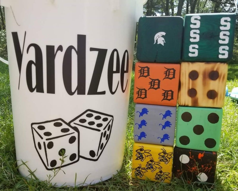 large wooden lawn dice with custom sports team logos