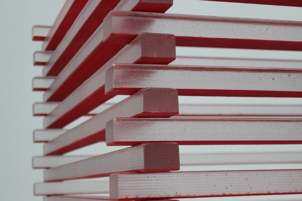 reddish gray stacked wooden rods