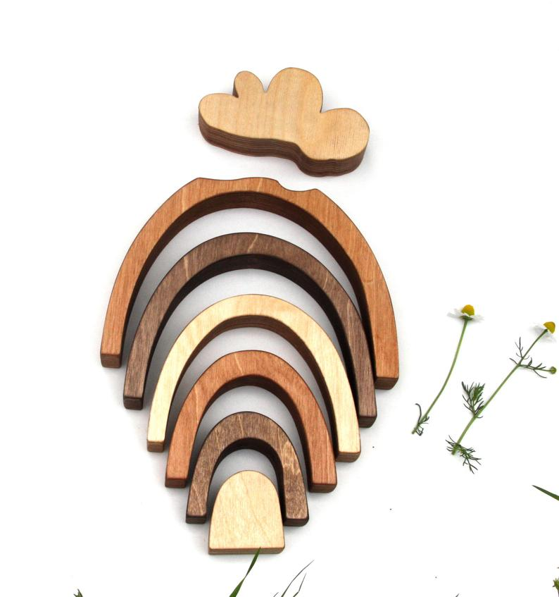 skin tone colored wooden rainbow toy with cloud