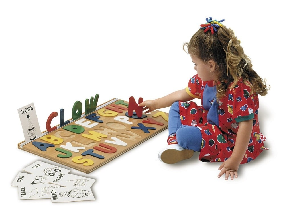 tag toys girl learning to spell with wooden letters puzzle