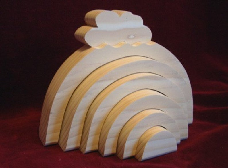 unpainted wooden rainbow tow with cloud top