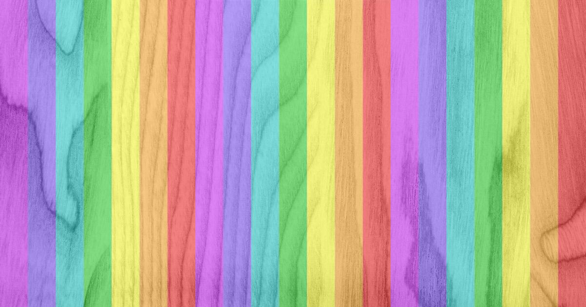 Wooden background with translucent rainbow stripes overlay.