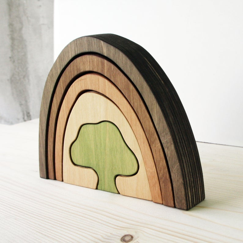 wooden rainbow toy with tree shaped core