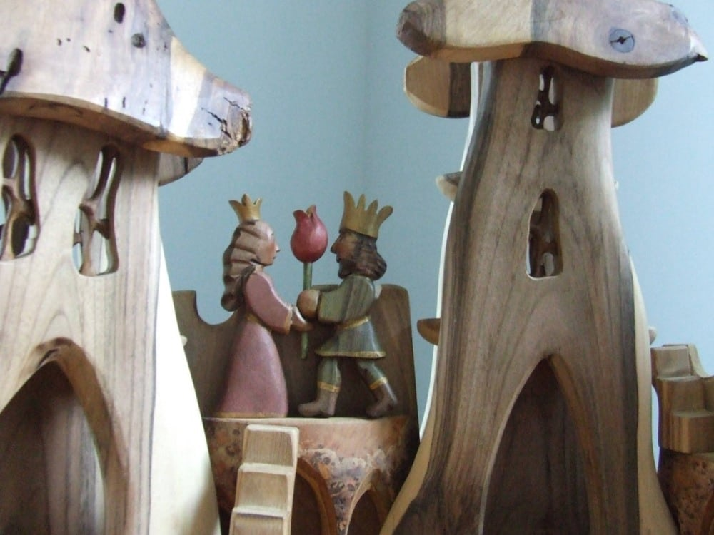 Davids wood store king and queen wooden castle figurines.