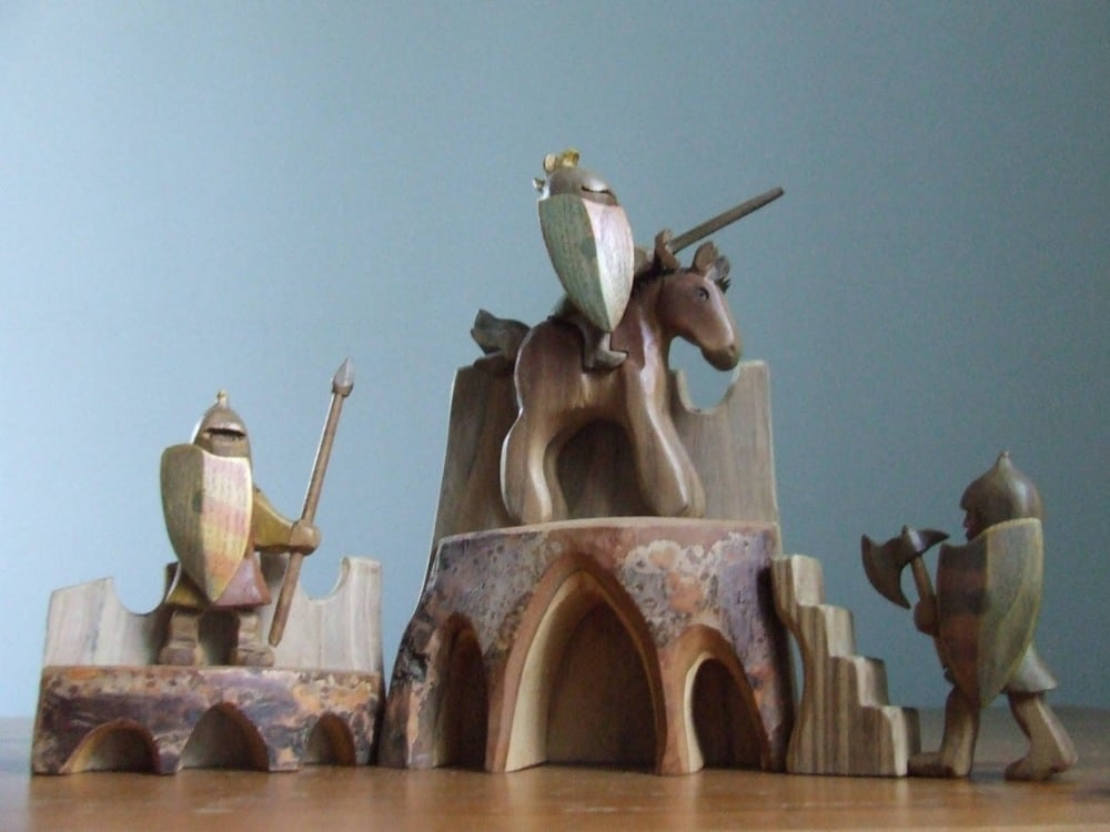 Davids wood store wooden knights figurines.