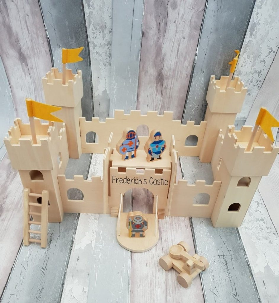 Holly & Fred brand handmade natural wood castle with personalized engraved name.