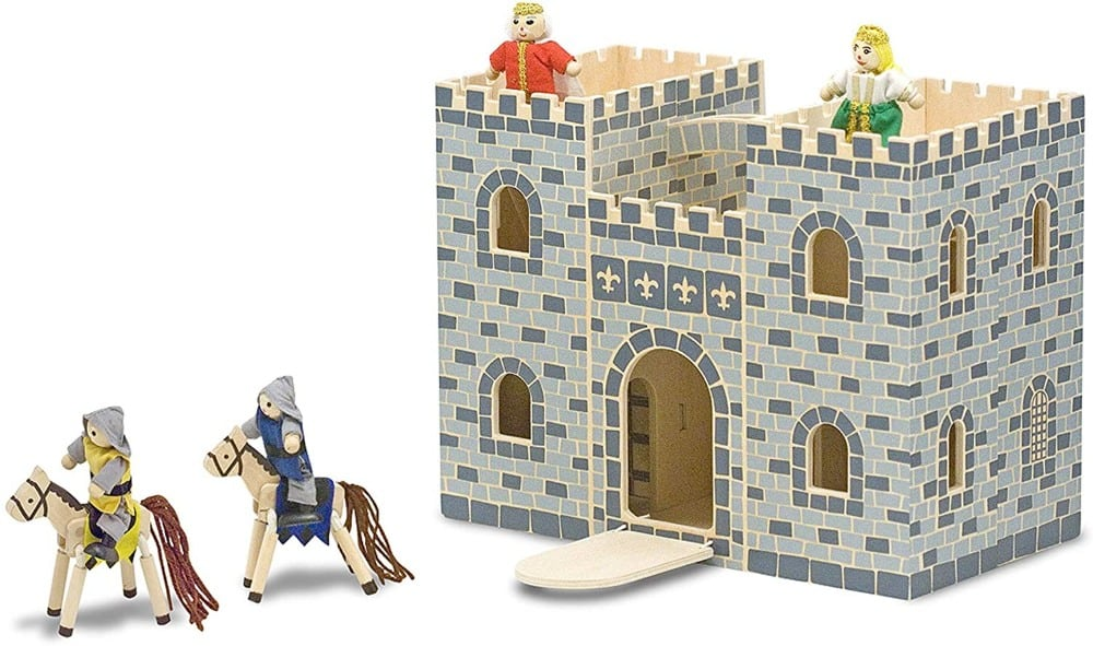 Melissa & Dougbrand folding wooden toy castle with figurines including a king, a queen, and some cavalry.