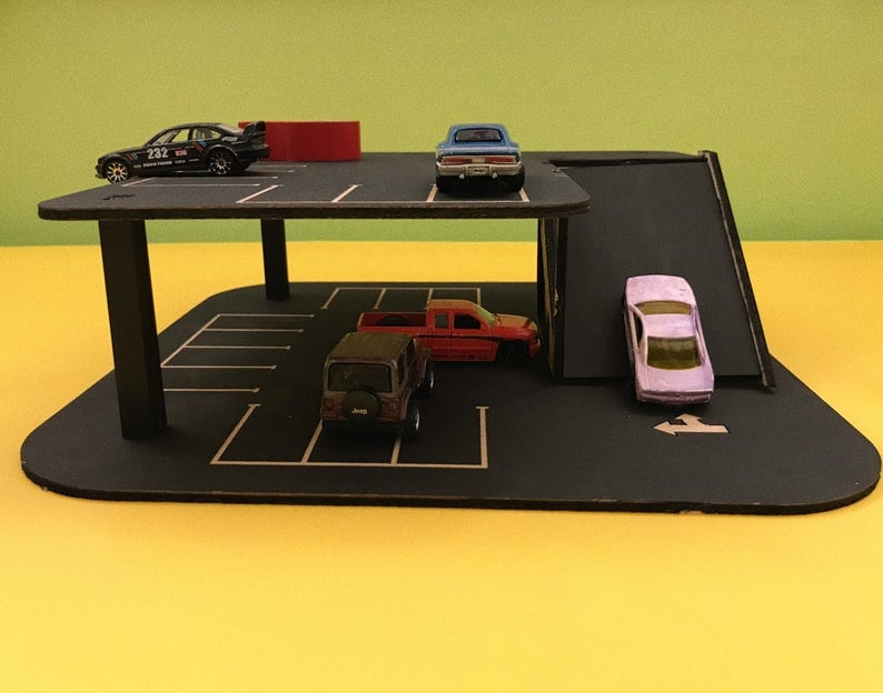 Roadville brand wooden car garage with car track addition.