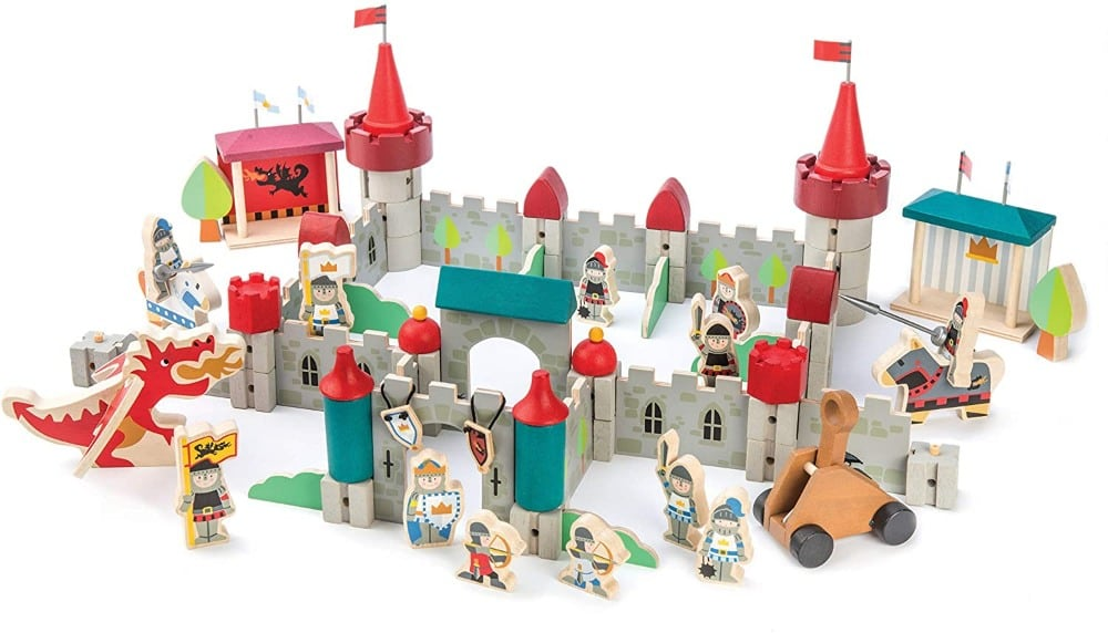 Tender Leaf Toys brand large Royal Castle wooden castle blocks set with figurines knights, horses, dragon, and trebuchet.