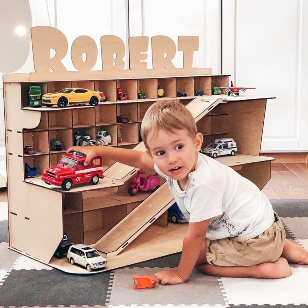 "Toy Box Addicted brand custom name wooden car storage garage with name ""Robert""."