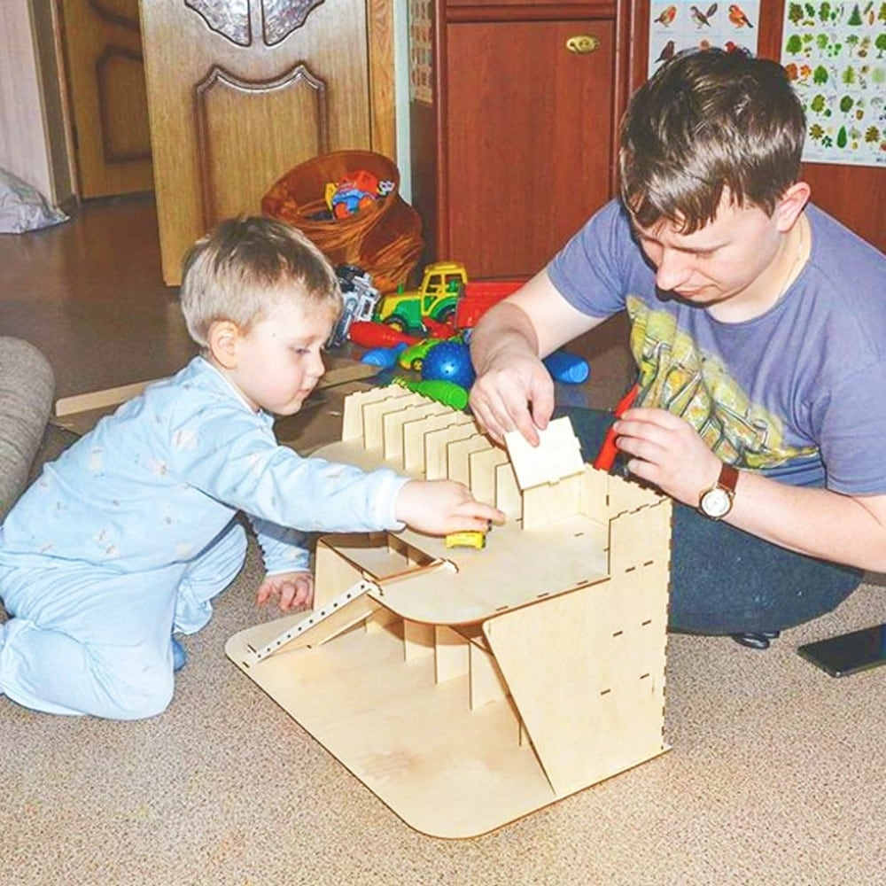 Father-son activity putting together a wooden garage toy by Toy Box Addicted brand.