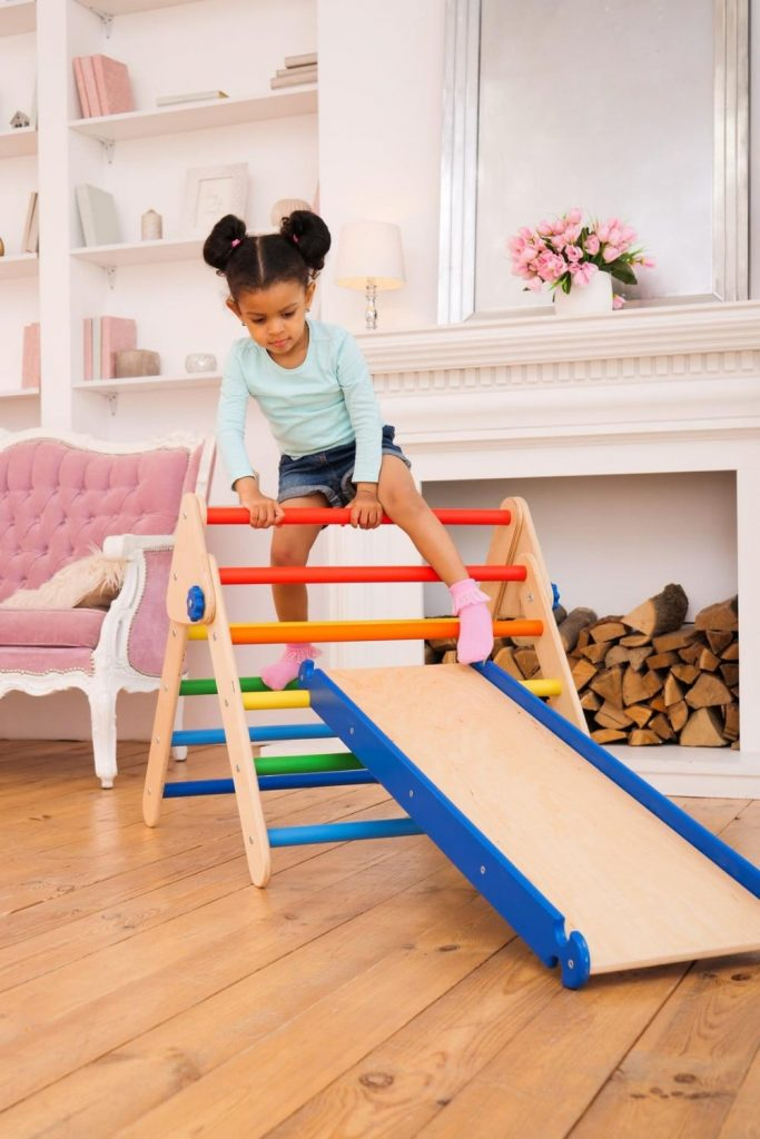Woodandhearts rainbow color wooden climbing gym set for toddlers.