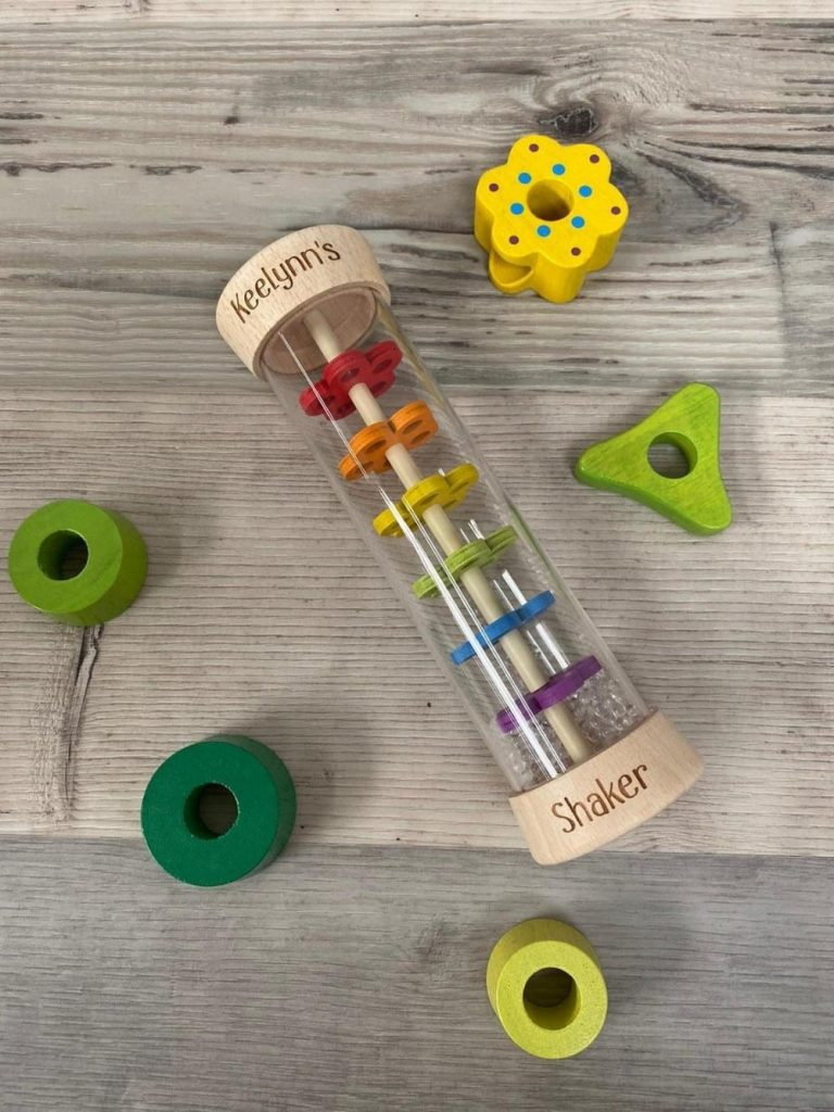 personalized wooden rainbow rattle rainmaker by raven skull magic