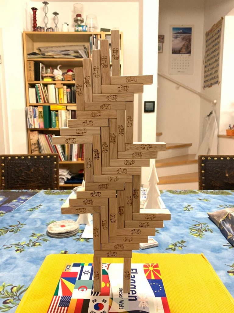 Contemporary Jenga Statue Balanced On Book